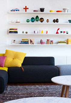 Love the idea of a low comfy sofa with loads of brightly coloured cushions for a funky look.