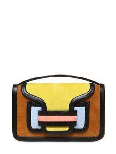 Spring Handbag Trend: A Color-Block Bag Pierre Hardy Bag 61 color-block suede clutch, $895, luisaviaroma.com