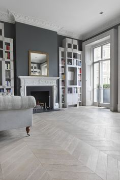 A classic living room in shades of grey including ash grey chevron flooring www.element7.co.uk