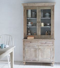 Loaf's country kitchen Bakewell dresser with chicken wire doors stacked with mismatched ceramics