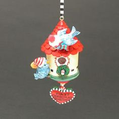 """A special Christmas Ornament for a First Christmas Together. Material is Resin Size is 4 3/4"""" Height x 2 1/2"""" in Width This is a bird house with a red roof and two birds that perched on the birdhouse."""