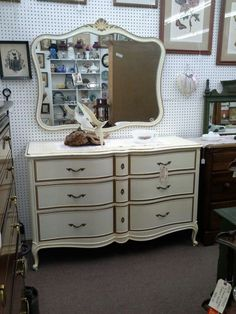 SOLD - This is a 6 drawer French provincial dresser by Drexel. It has the original matching mirror , wall hanging. Sold with the original finish as found. This test measures 54 inches across the front, 21 inches deep and it stands 35 inches tall. The mirror is an additional 37 inches in height. This set can be seen in booth C13 at Main Street Antique Mall 7260 East Main St ( E of Power Rd ) Mesa 85207  480 9241122open 7 days 10 till 530 Cash or charge 30 day layaway also availa...