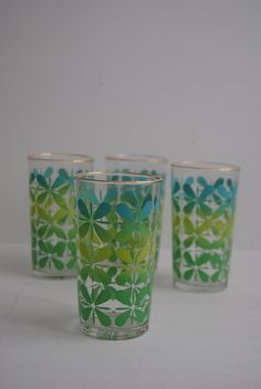 Mid Century Modern 8 oz Drinking Glasses - Juice Water Glass Cup Kitchen Kitschy Flower Pattern Asterisk Turquoise Green Tumbler Collectable. $24.00, via Etsy.