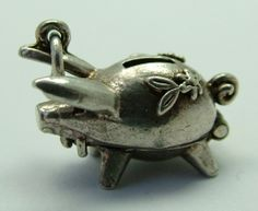1960s English silver charm of a piggy money bank that opens to reveal a button inside - 26gbp