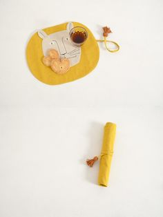 Portable placemats.  Oilcloth might be an interesting (and, moreover, mess-friendly)  option.