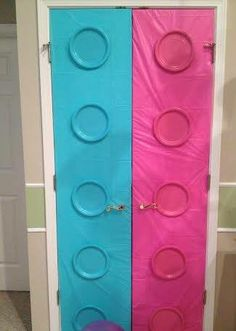 Lego Friends - Girl Birthday Party | Pantry doors decorated with Plastic Tablecloths - $1/EA and Paper Plates - $1/Pack