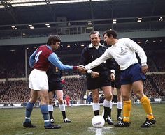 Aston Villa vs. Tottenham Hotspur in the League Cup final at Wembley in 1971. Skipper Brian Godfrey shakes hands with Spurs skipper Alan Mullery. The referee is Jim Finney.