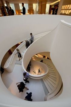 Guests traverse a staircase. Hermes has reopened in Beverly Hills.