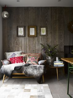 Warm and rustic with embroidered pillows! Emily Henson