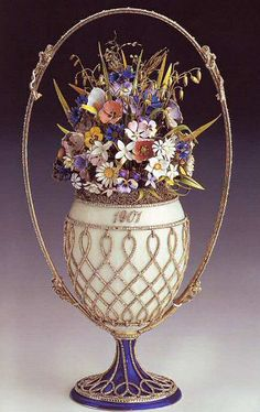 (1) FABERGE Egg__Basket of Wildflowers Egg Faberge 1901 - Egg the Basket of wild flowers, a product of the jeweler house of Faberge, was Nikolay's II Gift to the wife, the empress Alexander Fiodorovna, for Easter of 1901. Since 1933 belongs to Royal family of Great Britain, to initially Queen Mary and it is inherited by Queen Elizabeth II.