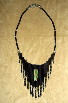 "The ""Kat"" - 2010 - Fixed Length, Sterling Silver beads and clasp, Green hand painted glass bead centerpiece, SOLD.  Woven by Terri Scache Harris, theravenscache.shutterfly.com   Hand woven, handwoven, weaving, weave, needleweaving, pin weaving, woven necklace, fashion necklace, wearable art, fashion necklace, fiber art."