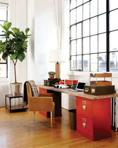 Desk made out of a butcher block and filing cabinets, love this!