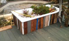 reclaimed timber offcuts used to make a surround for this bath (part of an aquaponics system) - Panarea, Italy