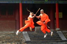 Blissweb Assignment Photography - Two Shaolin martial arts masters perform an aerial battle with bayoneted long sticks. Fa Wang Si (temple), Deng Feng, Henan Province, China.
