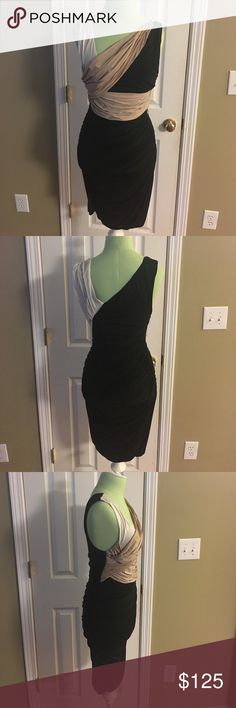 All saints sleeveless body con wrap dress This is a super fabulous all saints sleeveless body con ruched dress.  Colors are black and tan and white. Size 8. Beautiful flawless condition. See photos All Saints Dresses
