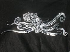 I've decided I'm a huge, huge, huge fan of these and want Sleek, sexy sea creatures as jewelry for my walls!!! Love the octopus, Jewfish, Lionfish and Lobsters!