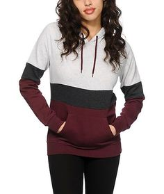 The purple, white and charcoal colorblock design will add some color to your daily look, while the soft and thick fleece construction offers absolute comfort.