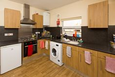 Forest Grove shared house: here's a typical kitchen, which includes a washing machine, fridge freezer and microwave. Forest Grove, Freezer, Washing Machine, Microwave, Home Appliances, Student, Kitchen, House, Ideas