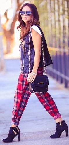 Red plaid harem pants, black leather vest, white tee, black sunnies, black bags and heels