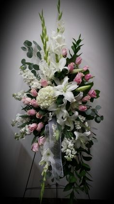 Beautiful arrangement but I'm not a big fan of the ribbons unless it would help a loved one to have one to keep in which case it should be a solid white silky ribbon with black lettering.