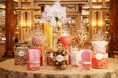 A Candy Buffet full of ivory, gold, and pink candies was displayed after dinner as part of our dessert offerings. Description from weddingbee.com. I searched for this on bing.com/images