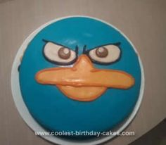 Homemade Agent P-Phineas and Ferb Cake: I used 2 8 chocolate round cakes with chocolate filling to make this Agent P-Phineas and Ferb Cake. I stuck to a boxed cake because we were on vacation!