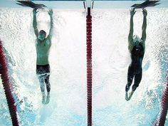 <p>American swimmer Michael Phelps out-touches Serbian swimmer Milorad Cavic by 0.01 seconds at the finish of the 100-meter butterfly final. It was the seventh of Phelps' record eight golds during the Olympics.</p><p>Photo: Heinz Kluetmeier/SI</p>