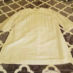 White linen Micheal Khors dress White linen Micheal Khors dress with beautiful embellishments on the front. Light yellow discoloration shown in second pic and small marks on bottom and right shoulder of dress...will probably come out at dry cleaner MICHAEL Michael Kors Dresses Midi