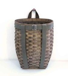 "A traditional handwoven ash basket perfect for foraging in the forest or just storing toys or laundry. With a double canvas bottom, a heavy canvas loop for hanging, and a removable canvas strap with double shoulder harness. Fits perfectly inside of our waxed canvas canoe bag.     19"" x 15"" x 10"""