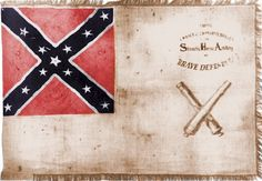 """Stuart's Horse Artillery Flag. After the Battle of Rio Hill on February 29, 1864 near Charlottesville, Virginia, the ladies of Charlottesville presented this flag to their """"...Brave Defenders."""" It was carried in battle until Major Roger Preston Chew and a number of the Horse Artillery surrendered at Durham's Station, NC on April 26, 1865. The flag bearer, Nimrod Ware of Jefferson County, saved the flag from capture."""