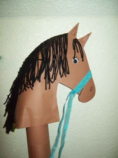 Horse Craft. DIY with construction paper, yarn, google eyes.  Printed horse head template from Internet. Great kids craft!