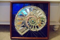 Using this as inspiration you could use small mirror bits, or various silver metallic beads to for this nautilus on a polymer clay base. Tile Art, Mosaic Art, Mosaic Glass, Fused Glass, Stained Glass, Glass Art, Mosaic Crafts, Mosaic Projects, Mosaic Ideas