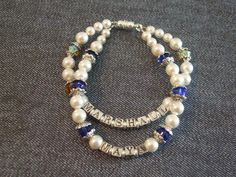 Mother's bracelet with child's name beads and each child's birthstone adorned with pearls.