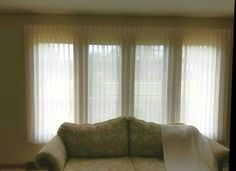 Vertical Sheers are great in bay windows in a living room to a texture, color and mood. http://www.toledo-window-treatments-windows-blinds-coverings-drapery.com/blog/