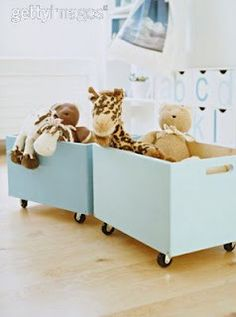 Cute Toy Storage: Teal wood boxes on wheels.