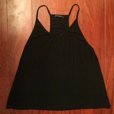 Brandy Melville back ribbed tank top size small Brandy melville black ribbed tank top. Worn once. Measured laying flat (inches) top of back to bottom hem: 22  arm pit to arm pit 16 1/2 non adjustable strap: 4 Brandy Melville Tops Tank Tops