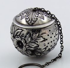 """Wallace Antique Sterling Repousse Tea Ball    A large hand chased sterling silver tea ball by Wallace. Large hand chased flowers and leaves. Good strong hinge that hinges back to open. 1 3/4"""" across.    Price: 435.00"""
