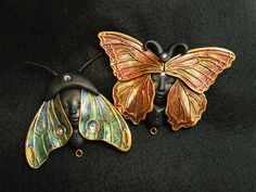 Art Nouveau Butterfly. lovely. these are most likely polymer, but it could be done in a clay and added to anything. just lovely.