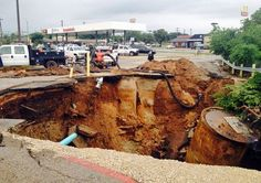 A large sinkhole opened in the pavement in front of