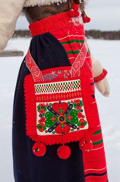The attention grabbingly bright red of a traditional Boda costume from Norway. #Norway #Norwegian #traditional #costume #clothing #folk #dress #travel #woman