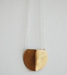 Brass Shield Necklace | Let this hand-formed brass shield pendant serve as your (very ... | Necklaces