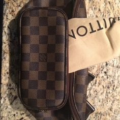 Brand new Authentic Louis Vuitton waist bag.. This is an authentic Louis Vuitton Damier Melville Bum bag. This stylish fanny pack is crafted of signature Louis Vuitton Damier check canvass in ebene brown. The bag features an adjustable nylon waist strap with a LV buckle and chocolate brown leather trim. This convenient bum bag features three zipped compartments for securing essentials for the day from Louis Vuitton. Louis Vuitton Bags Mini Bags