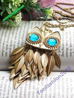 Pretty retro gold blue eyes owl with feathers necklace pendant vintage style #owl #necklace www.loveitsomuch.com