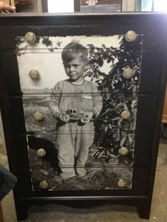 Enlarge and decopage a photo onto a dresser. A great way to showcase older photos of family members.