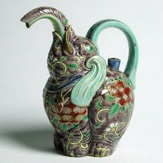 Elephant Teapot - made in the city of Kaga in the prefecture of Ishikawa on the west coast of Japan, a location famed for its brightly colored porcelains. Now, it delights visitors to the Museum of Applied Culture in Vienna.