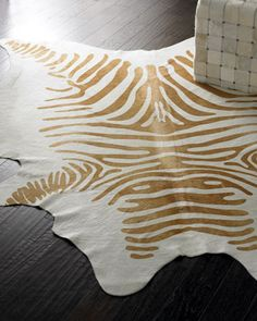 "This would be a great rug for George.Cream ""Zebra"" Hide Rug at Horchow."