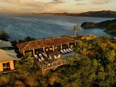Origins offers untamed luxury, with six spacious rooms and an incredible three-bedroom villa in northern Costa Rica. The craftsmanship blends stone, wood, and bamboo with hand-crafted furnishings, high-end amenities, and spectacular views of the valley below. - Hands Up Holidays.