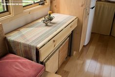 pequod-tiny-house-rocky-mountain-tiny-houses-4 Drop-leaf table with slide-out bench/coffee table and storage box seats sits 4!