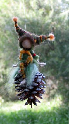 Needle felted mobile with Waldorf inspired gnome sitting an a cone. Made in shades of fall colors.  Very special home decoration, kids room and