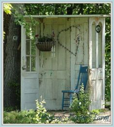 5 Old Doors...hinged together & re-purposed into a sweet garden retreat!!